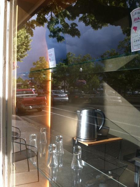 Street scene, reflection on window