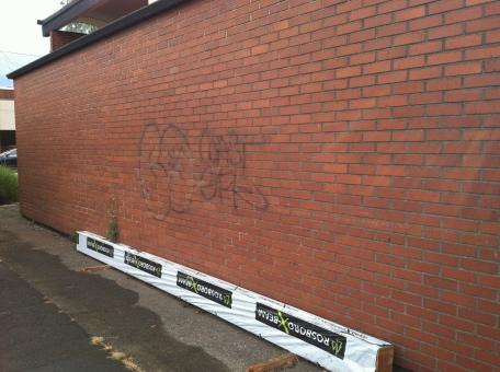 brick wall with graffiti on it
