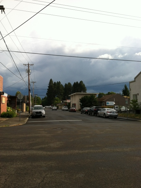 Street in another direction, storm clouds brewing