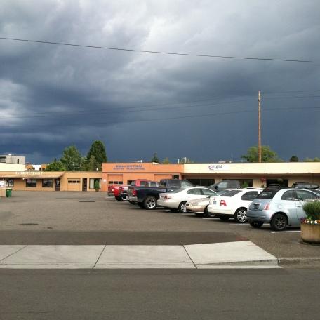 Storm sky over Beaverton auto machine shop.