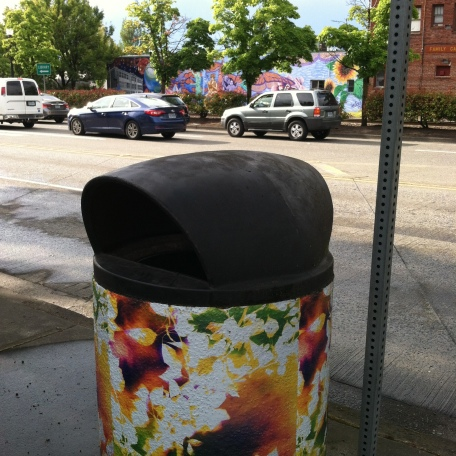 Art covered city trash can.