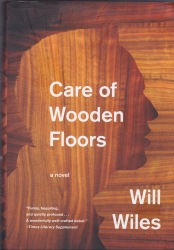 Front book cover for Care of Wooden Floors, printed in a wood-grain floor design.