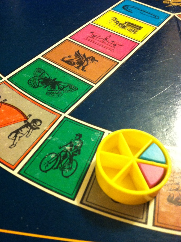 Edge of a Trivial Pursuit board game with bike on the green space